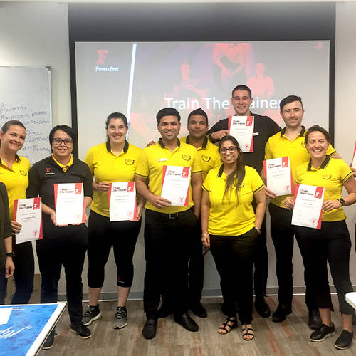 Fitness First employees holding their certificates after a training session